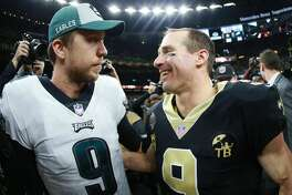 NEW ORLEANS, LOUISIANA - JANUARY 13: Nick Foles #9 of the Philadelphia Eagles congratulates Drew Brees #9 of the New Orleans Saints after his team was defeated by the Saints 20 -14 during the NFC Divisional Playoff at the Mercedes Benz Superdome on January 13, 2019 in New Orleans, Louisiana. (Photo by Sean Gardner/Getty Images)