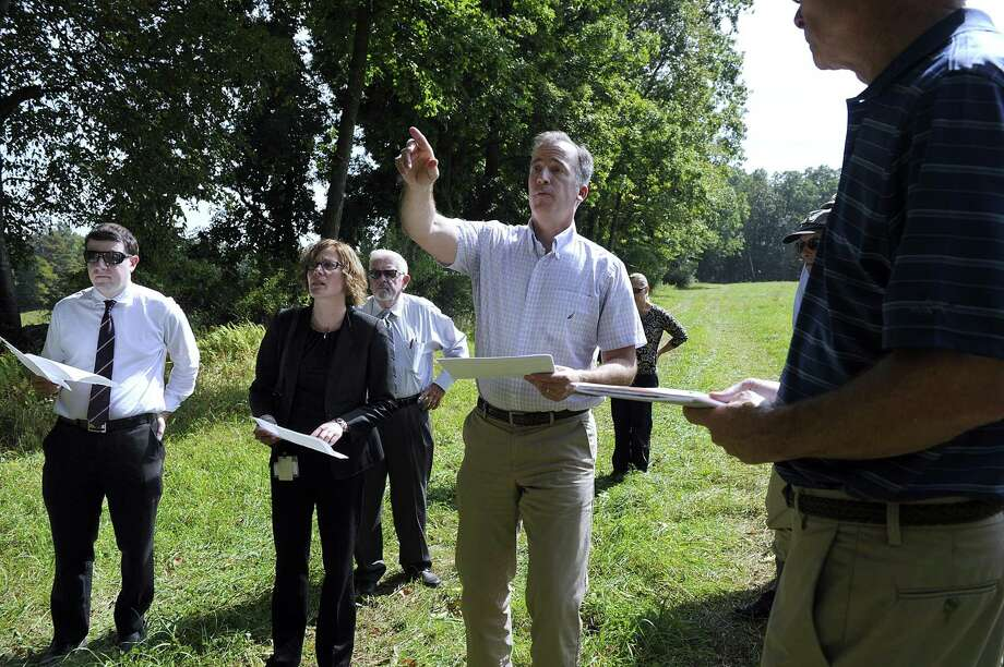 Joel Lindsay, with Ameresco Candlewood Solar, led the state Siting Council on a 2017 walking tour of the area proposed for a solar array on Candlewood Mountain in New Milford. Photo: Hearst Connecticut Media File Photo / The News-Times