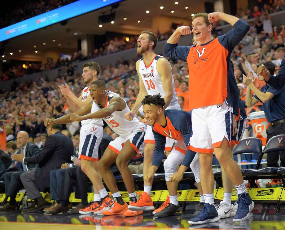 The Virginia bench celebrates during the Cavaliers' 81-59 victory over Virginia Tech on Tuesday in Charlottesville, Va. Photo: Washington Post Photo By John McDonnell / The Washington Post