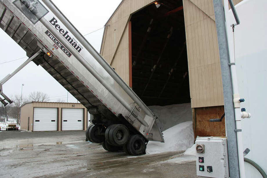 Finished with emptying its load, this Beelman Truck Co. trailer begins to pull away from the salt dome at the Edwardsville Street Department Thursday. Another load of rock salt was due to arrive before the end of the day as the city cranks up to battle a potential snowstorm this weekend. Photo: Charles Bolinger | The Intelligencer
