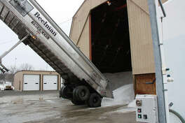 Finished with emptying its load, this Beelman Truck Co. trailer begins to pull away from the salt dome at the Edwardsville Street Department Thursday. Another load of rock salt was due to arrive before the end of the day as the city cranks up to battle a potential snowstorm this weekend.