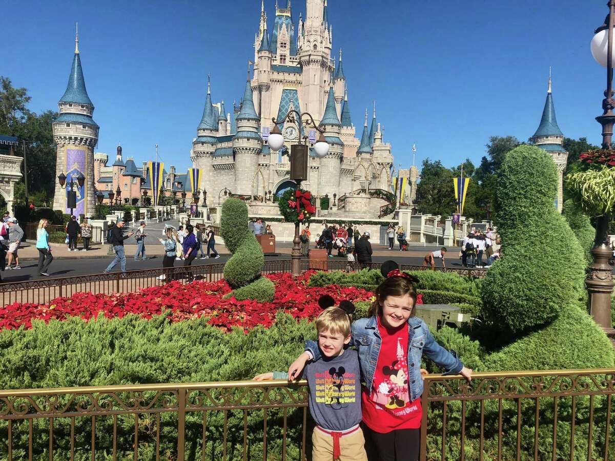 Louise and Thomas Bagley at Magic Kingdom, excited about their first trip to Disney.