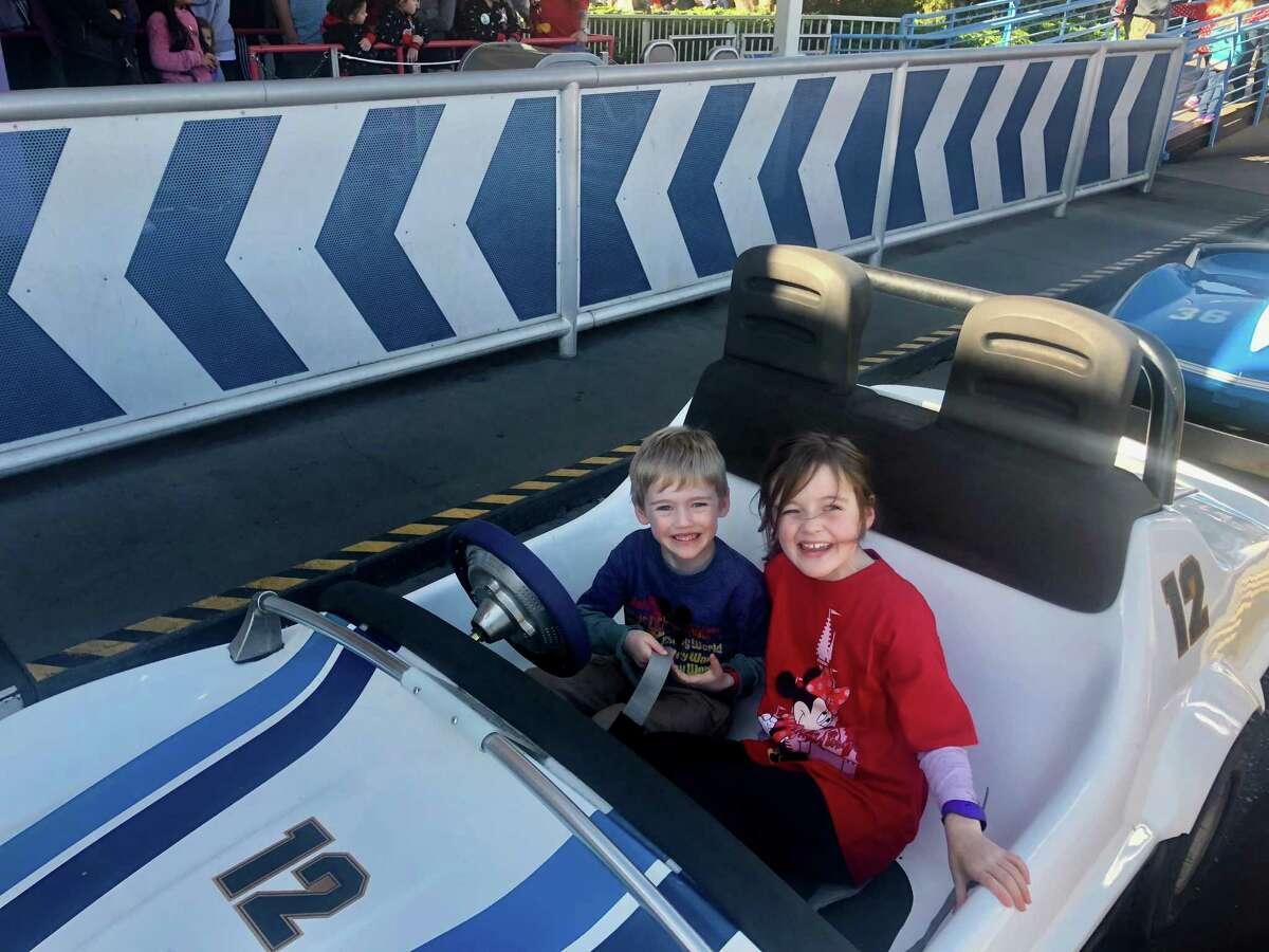 Louise and Thomas Bagley take a ride at Magic Kingdom.