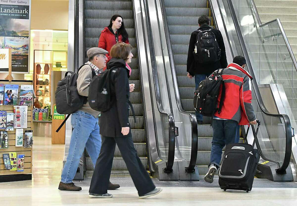 Travelers are seen at the Albany International Airport on Friday, Jan. 18, 2019 in Colonie, N.Y. Members of the National Air Traffic Controllers Association were on hand to inform travelers of how the partial government shutdown is detrimental to the safety and efficiency of the National Airspace System. (Lori Van Buren/Times Union)