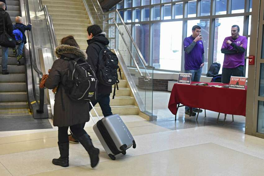 Members of the National Air Traffic Controllers Association were at Albany International Airport to inform travelers of how the partial government shutdown is detrimental to the safety and efficiency of the National Airspace System on Friday, Jan. 18, 2019 in Colonie, N.Y. (Lori Van Buren/Times Union)