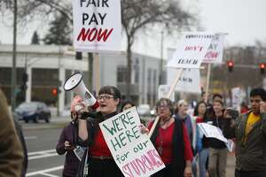 Teachers from several schools gather at Oakland Technical High School for a march to school district offices to warn administrators of a possible strike if their contract demands aren't met in Oakland, Calif. on Friday, Jan. 18, 2018.