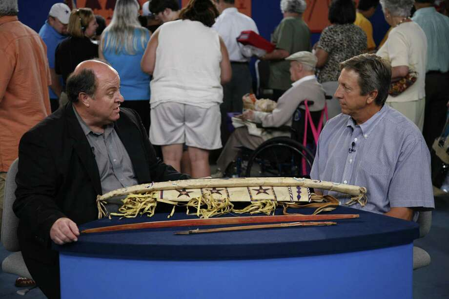 "Bruce M. Shackelford (left) appraises a Geronimo-signed bow case and quiver at the 2007 'Antiques Roadshow' San Antonio event. Shackelford is an expert in tribal art and is based in San Antonio. It's uncertain if he will appraise at the April 27, 2019, ""Roadshow"" event at the McNay Art Museum. Photo: Jeffrey Dunn /WGBH"