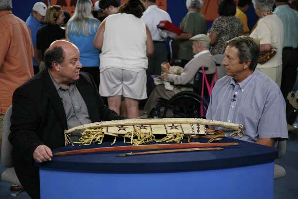 "Bruce M. Shackelford (left) appraises a Geronimo-signed bow case and quiver at the 2007 'Antiques Roadshow' San Antonio event. Shackelford is an expert in tribal art and is based in San Antonio. It's uncertain if he will appraise at the April 27, 2019, ""Roadshow"" event at the McNay Art Museum."
