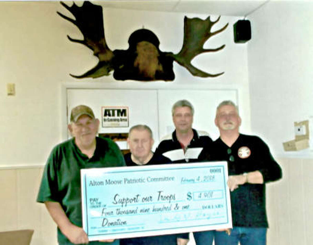 Tommy Lowe, President of the Alton Moose Patriotic Committee, accepts a check for $4,901 from Max Robertson, Lodge Administrator, last February. David W. Hayes, Project Coordinator, and Chipper Mohr, Master of Ceremony, look on.