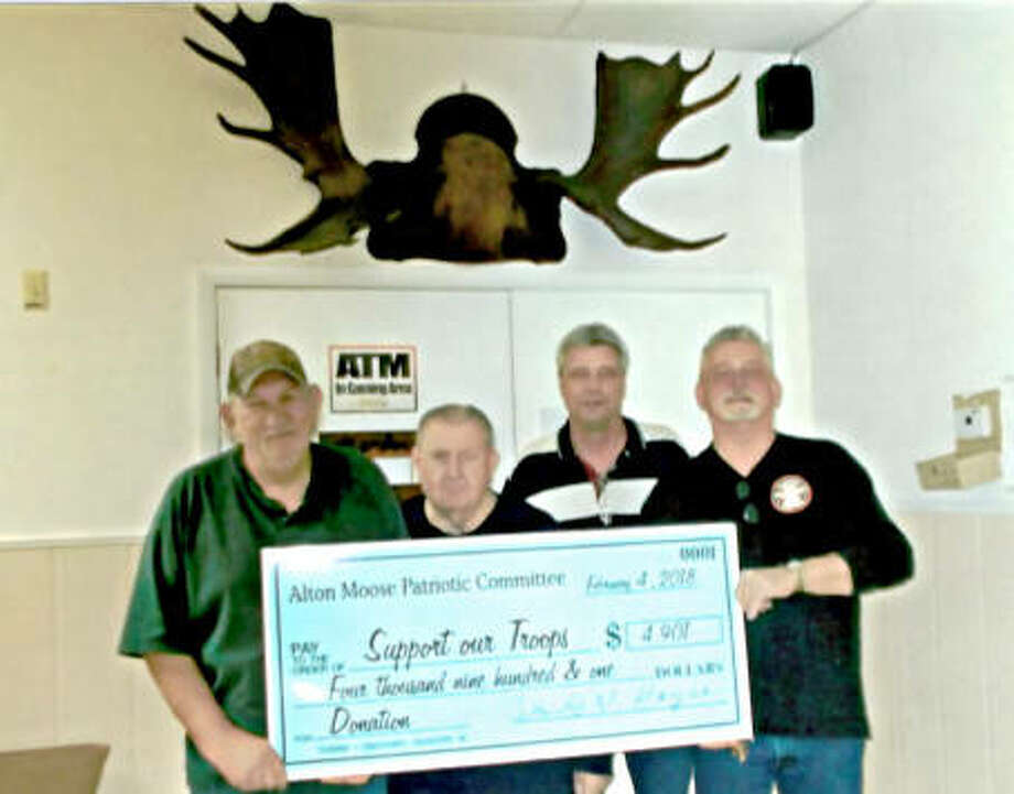 Tommy Lowe, President of the Alton Moose Patriotic Committee, accepts a check for $4,901 from Max Robertson, Lodge Administrator, last February. David W. Hayes, Project Coordinator, and Chipper Mohr, Master of Ceremony, look on. Photo: For The Telegraph