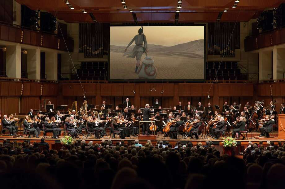 """The National Symphony Orchestra performs the score of """"Star Wars: The Force Awakens"""" while it is played onscreen at the Kennedy Center. Photo: Scott Suchman / Scott Suchman"""