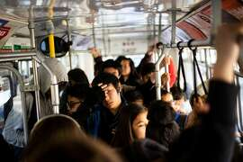 Riders on a crowded SF Muni bus on Thursday, Sept. 13, 2018. The 2019 biennial survey of city residents had some choice words for Muni - but, as Caille Millner notes, it's just a symptom of larger resident ire.