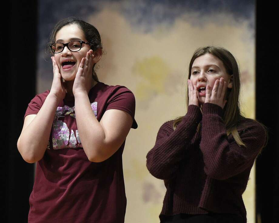 "Members of the eighth grade show chorus at Eastern Middle School in the Riverside section of Greenwich rehearse the show ""Annie."" The musical will be performed at 7:30 p.m. Saturday in the school's Lee Book Auditorium. Tickets are $15. Ticket reservations can be made via email by contacting Tara Hoffman at tara_hoffman@greenwich.k12.ct.us. Photo: Tyler Sizemore / Hearst Connecticut Media / Greenwich Time"