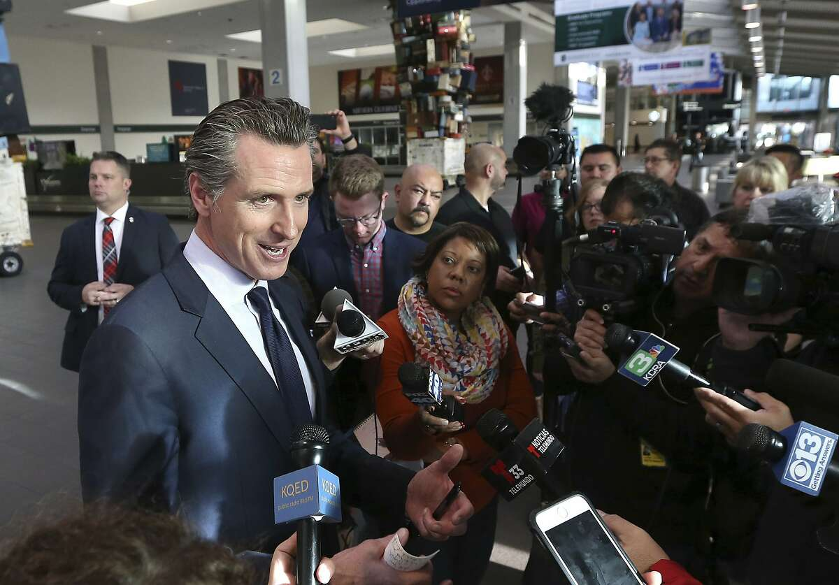 California Gov. Gavin Newsom told reporters that California will offer unemployment benefits to federal employees working without pay after meeting with TSA workers at the Sacramento International Airport, Thursday, Jan. 17, 2019, in Sacramento, Calif. Newsom announced last week that Californians employed by the federal government could get benefits during the government shut down despite guidance saying it's not allowed. (AP Photo/Rich Pedroncelli)