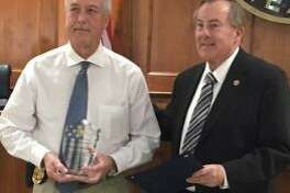Katy Police Chief William Hastings, left, received an award in appreciation for his 32 years of service with the department from Katy Mayor Chuck Brawner at the Jan. 14 Katy City Council meeting. Hastings had served as police chief since 2008. Jan. 15 was his last day on the job.