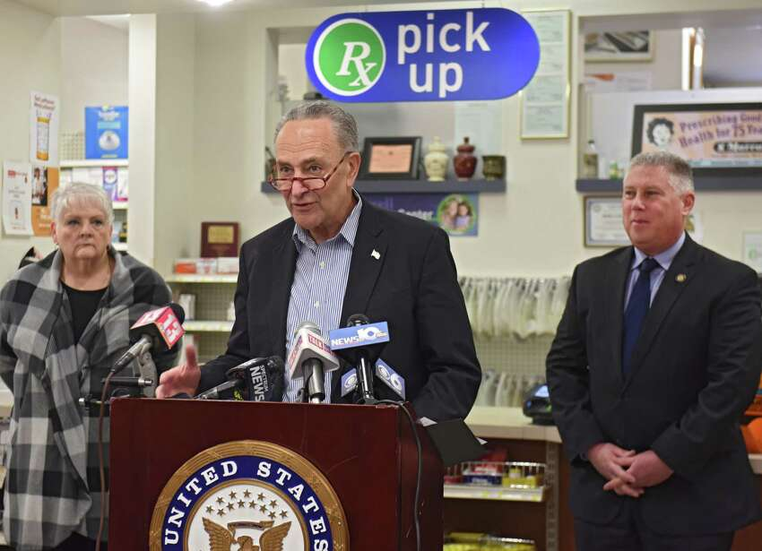 U.S. Senator Charles Schumer reveals that the Capital Region is experiencing an alarming shortage of the Shingles vaccine during a press conference at Marra's Pharmacy on Friday, Jan. 18, 2019 in Cohoes, N.Y. He said that left unsolved, it could spread the painful and harmful virus to many this winter. Assemblyman John McDonald, pharmacist and owner of Marra's Pharmacy, stands at right. Sharon Mitchell, a retired school teacher from Cohoes, stands at left. She is on the waiting list for the vaccine. (Lori Van Buren/Times Union)