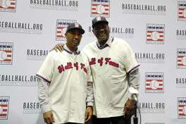 Lee Smith, right, and Harold Baines pose for photographers during a news conference for the National Baseball Hall of Fame during the Major League Baseball winter meetings, Monday, Dec. 10 in Las Vegas.