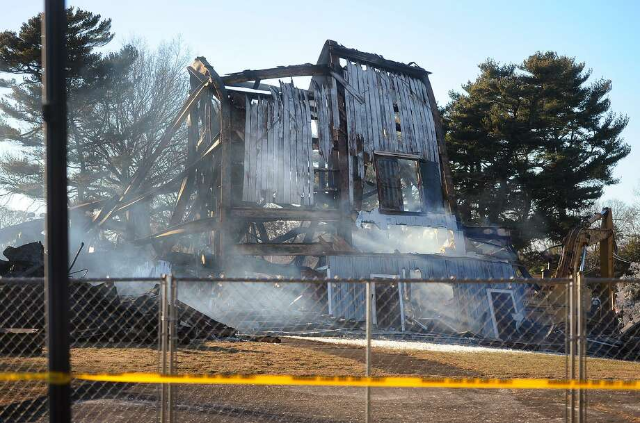 Smoke rises from the remains of the Shakespeare Theater in Stratford, Conn. on Monday, January 14, following a fire early Sunday morning that engulfed the structure. Photo: Brian A. Pounds / Hearst Connecticut Media / Connecticut Post