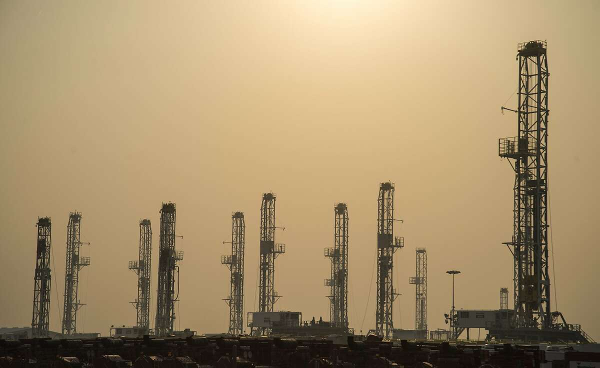 Drilling rigs stacked in a yard in Odessa are partially obscured by smoke from a large grass fire near Amarillo. Tim Fischer/Reporter-Telegram