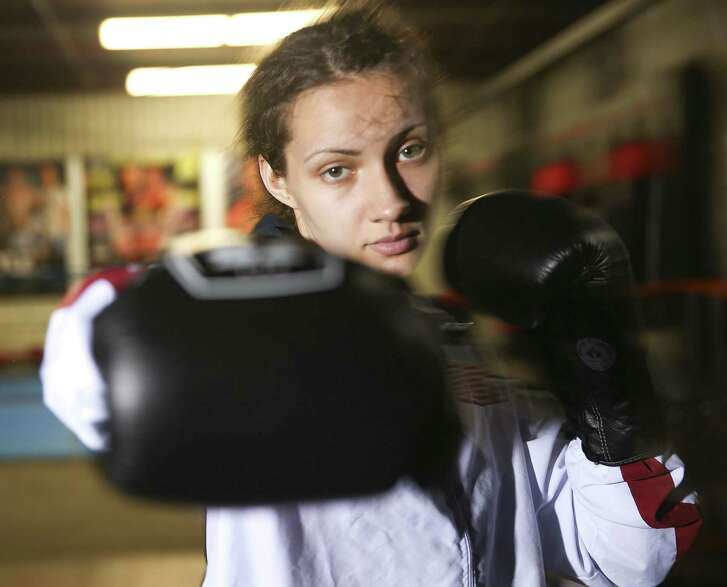 Rebekah Irwin poses for a photo outside Heritage Muay Thai gym on Wednesday, Jan. 16, 2019. The 18-year-old kickboxer is going pro with her first professional fight in February.