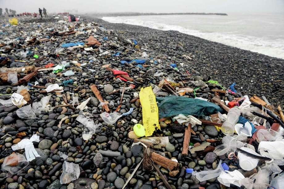 Volunteers clean up plastic waste on a beach in Lima, Peru in 2018. / AFP PHOTO / ERNESTO BENAVIDESERNESTO BENAVIDES/AFP/Getty Images Photo: ERNESTO BENAVIDES, Contributor / AFP/Getty Images / AFP or licensors
