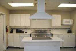 The HomeAid Heroes program funds small construction projects such as the renovation of this kitchen for A Caring Safe Place, a transitional living facility that provides crisis intervention services for men living with HIV who are also victims of drug and physical abuse, and abandonment.