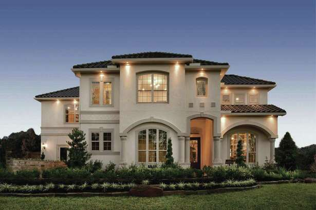 Shown is The Vitoria Mediterranean-style model home for sale in Sienna Plantation.