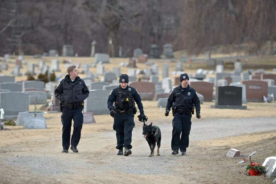 Police officers search Wooster Cemetery near Danbury Hospital after a shooting on Thursday afternoon. January 17, 2019, in Danbury, Conn. Photo: H. John Voorhees III