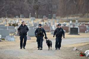 Police officers search Wooster Cemetery near Danbury Hospital after a shooting on Thursday afternoon. January 17, 2019, in Danbury, Conn.