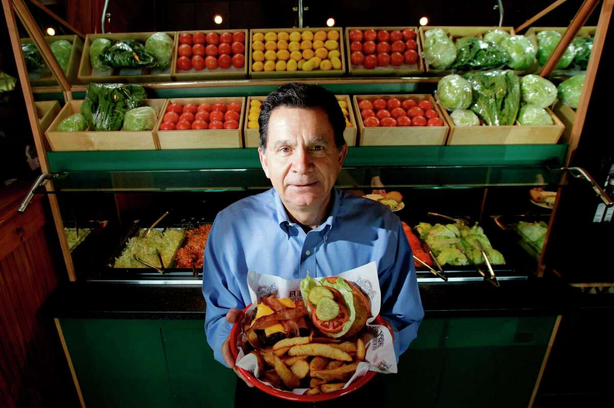 Chris Pappas, formerly chief executive officer of Luby's, poses for the Houston Chronicle in front of the condiments bar inside a Fuddruckers restaurant on Thursday, Oct. 7, 2010, in Houston.