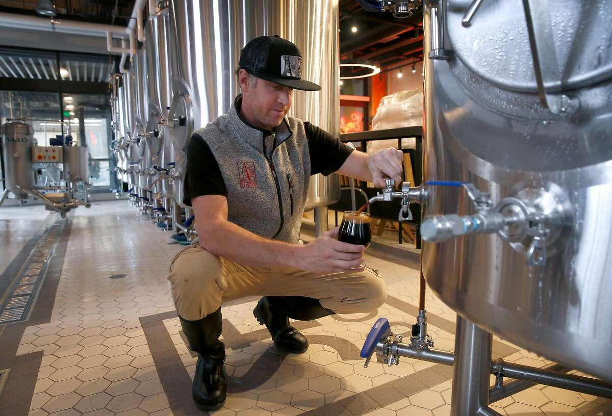 San Francisco Brewing Company owner Josh Leavy pours a sample of a beer in production at his new brewery and restaurant at Ghiradelli Square in San Francisco, Calif. on Thursday, Jan. 17, 2019.