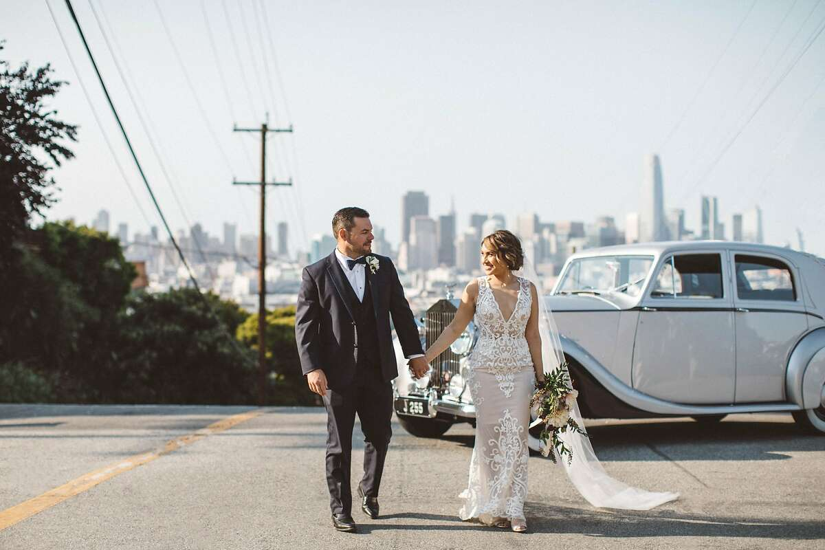 """After happily dating for almost 12 years, Christina Castro, 31, a second-generation daughter of the Mission District, and 33-year-old Conor Coyne, a fifth-generation San Francisco native who grew up in the Inner Richmond, finally took the marital plunge. On Aug. 11, 2018, the couple wed at the historic St. Paul's Church, an English Gothic beauty in Noe Valley also known cinematically as the """"Sister Act"""" church. The held their reception at the Pearl in Dogpatch."""