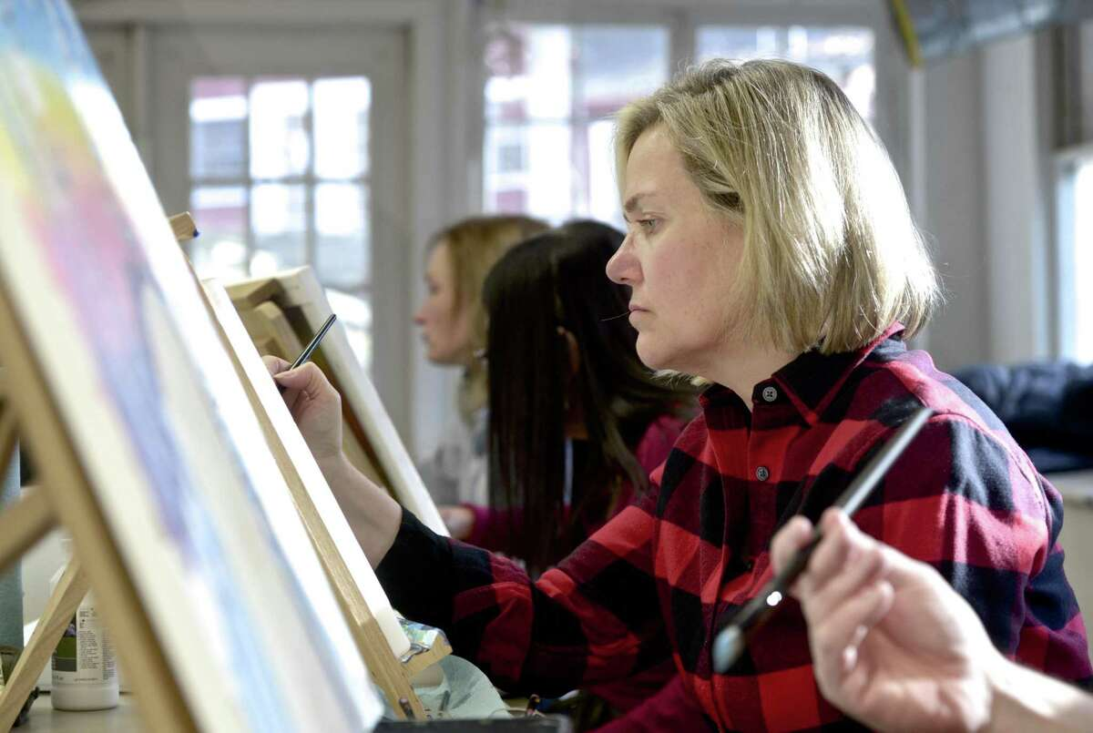 Pamela Cassidy, of Danbury, works on a painting during an Acrylic Painting for Beginners class at the Brookfield Craft Center. Brookfield is forming a committee to designate the center, which was founded in 1952, as a historic destination. Tuesday, January 15, 2019, in Brookfield, Conn.