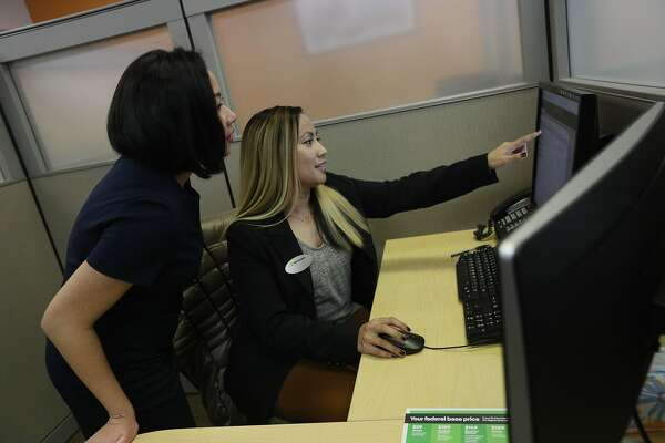 Fransiska Kane (l to r), tax professional and Nathellyn Olano, tax professional, discuss a clients case as they work together at a H&R Block office on Mission Street on Friday, January 18, 2019 in San Francisco, Calif.