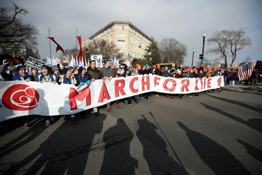 Protesters carry a banner as they march past the U.S. Supreme Court building January 18, 2019 in Washington, DC. The Right to Life Campaign held its annual March For Life rally and march to the U.S. Supreme Court protesting the high court's 1973 Roe V. Wade decision making abortion legal. Photo: Mark Wilson/Getty Images