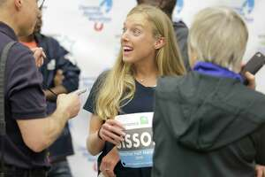 Elite half runner Emily Sisson talks with the media after a press conference featuring elite runners at George R. Brown Center on Friday, Jan. 18, 2019 in Houston.