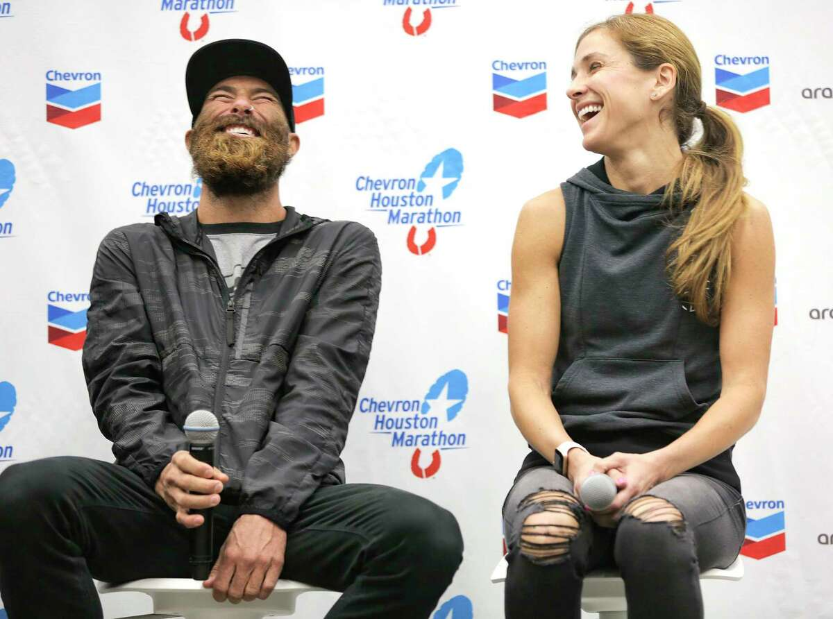Thomas Rivers Puzey laughs as he answers questions next to Kara Goucher during the Chevron Houston Marathon and Aramco Houston Half Marathon press conference at the George R. Brown Center on Friday, Jan. 18, 2019 in Houston.