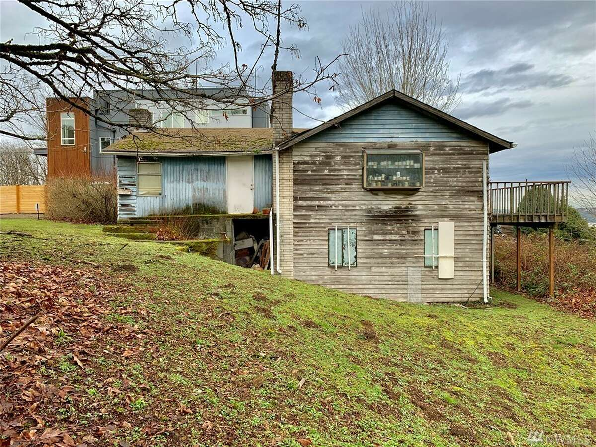 On two parcels with potential for three lots, this property's value is all in the land-- asking $1M