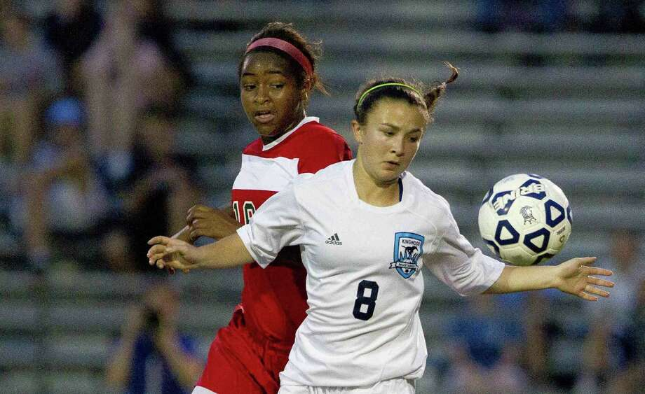 Kingwood's Catherine Childs looks to control the ball as The Woodlands forward Jazzy Richards chases her down during the first period of a District 16-6A girls soccer game at Kingwood High School Friday. The Woodlands defeated Kingwood 3-0. Go to HCNpics.com to purchase this photo and others like it. Photo: Jason Fochtman / Internal