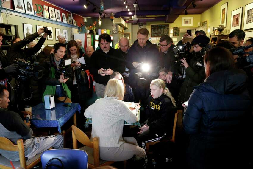 U.S. Kirsten Gillibrand, D-N.Y., with back to camera, sits down for a chat with Jeanette Hopkins, rear, and Chloe McClure, right, at the Pierce Street Coffee Works cafe' in Sioux City, Iowa, Friday, Jan. 18, 2019. Sen. Gillibrand is on a weekend visit to Iowa, after announcing that she is forming an exploratory committee to run for President of the United States in 2020.