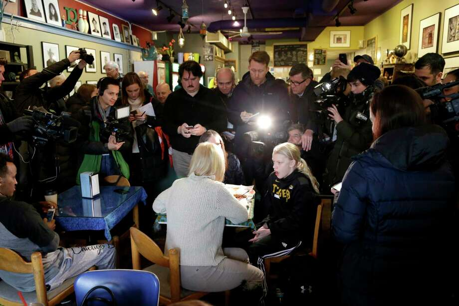 U.S. Kirsten Gillibrand, D-N.Y., with back to camera, sits down for a chat with Jeanette Hopkins, rear, and Chloe McClure, right, at the Pierce Street Coffee Works cafe' in Sioux City, Iowa, Friday, Jan. 18, 2019. Sen. Gillibrand is on a weekend visit to Iowa, after announcing that she is forming an exploratory committee to run for President of the United States in 2020. Photo: Nati Harnik, AP / Copyright 2019 The Associated Press. All rights reserved