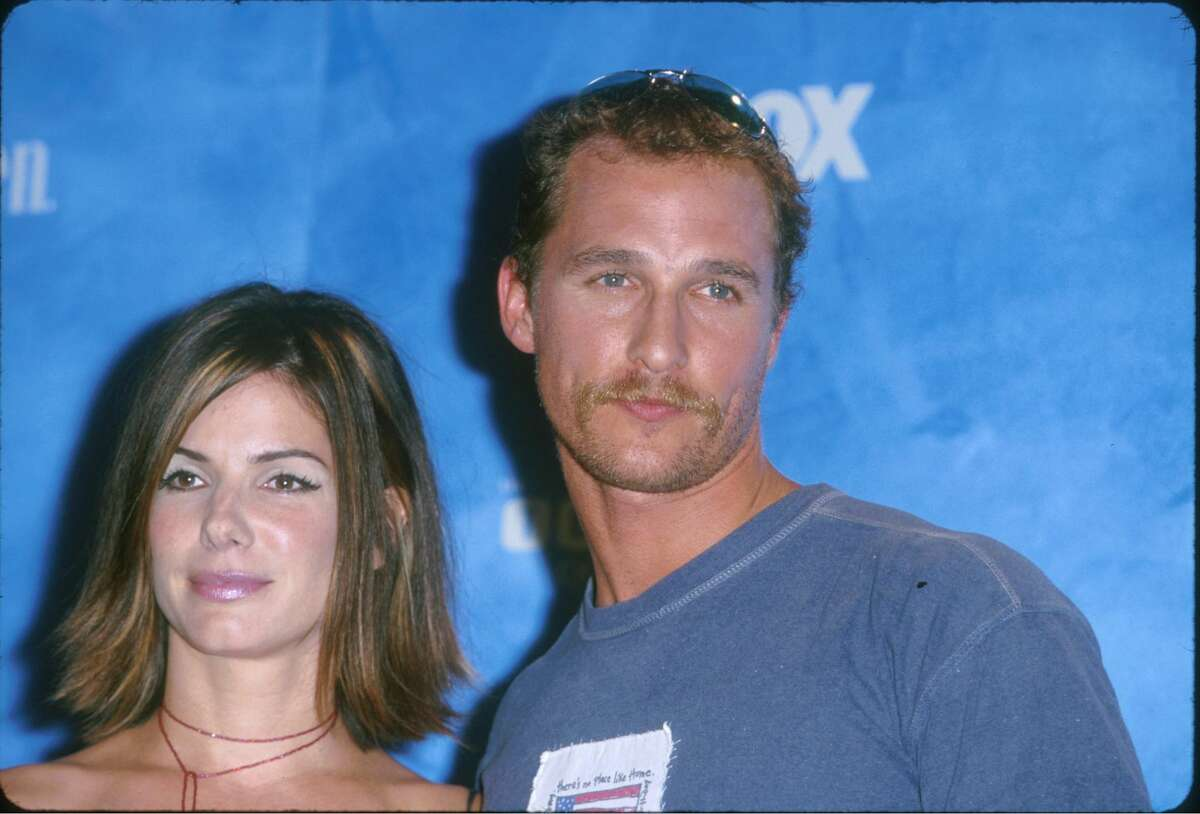 Sandra Bullock and Matthew McConaughey. (Photo by SGranitz/WireImage) >>> Click through to see more celebrity couples from the '90s.
