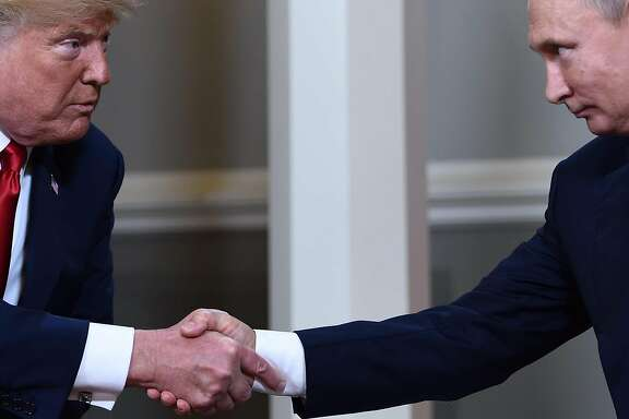 "(FILES) In this file photo taken on July 16, 2018, US President Donald Trump (L) and Russian President Vladimir Putin shake hands ahead a meeting in Helsinki. - Call Donald Trump an egomaniac, call him a showoff. Accuse him of getting kicks from insulting and humiliating people. The thing is, he might just agree. The uniqueness of the 45th US president among world leaders extends to the pride he takes in his brazenly unconventional persona. Trump doesn't just admit to a litany of character flaws and actions that would sink an ordinary politician. He revels in them. ""The show is 'Trump' and it is sold-out performances everywhere. I've had fun doing it and will continue to have fun."" On January 20, 2019, 72-year-old Trump reaches the halfway mark of his presidency's first term. (Photo by Brendan Smialowski / AFP)BRENDAN SMIALOWSKI/AFP/Getty Images"