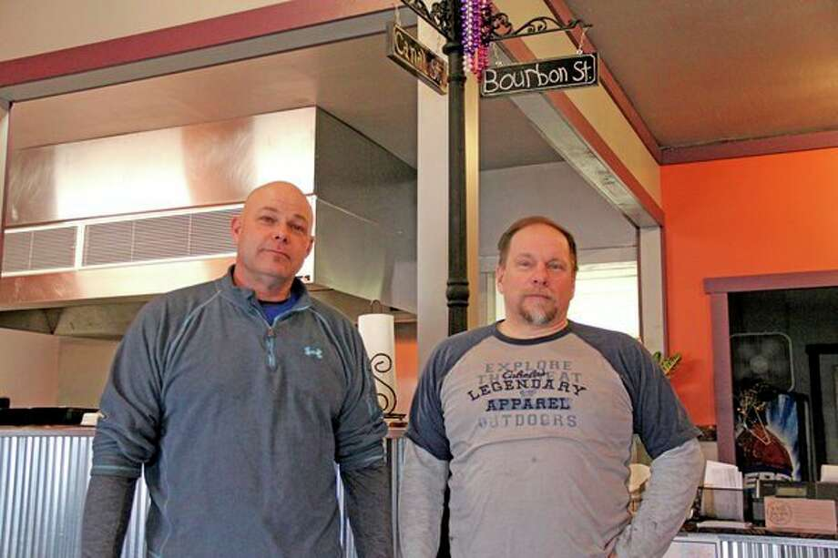 Business partners Steve Kretzschmer (left) and Steve Farlow pose inside Kretzschy's Smokey BBQ, a new restaurant in Sebewaing. (Mike Gallagher/Huron Daily Tribune)
