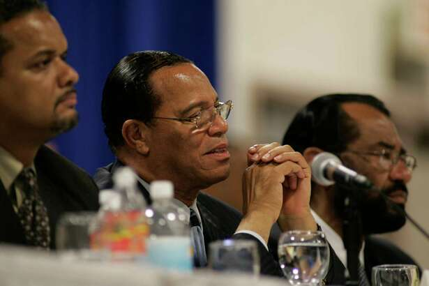 """09/11/05--Minister Louis Farrakhan along with Joshua Farrakhan, far left, and State Rep. Al Green, far right, listen to survivors of Hurrican Katrina during a National Town Hall Meeting at the Power Center Sunday afternoon. Minister Farrkhan visited Houston while on a """"fact-finding mission."""" Nathan Lindstrom/Special to the Chronicle"""