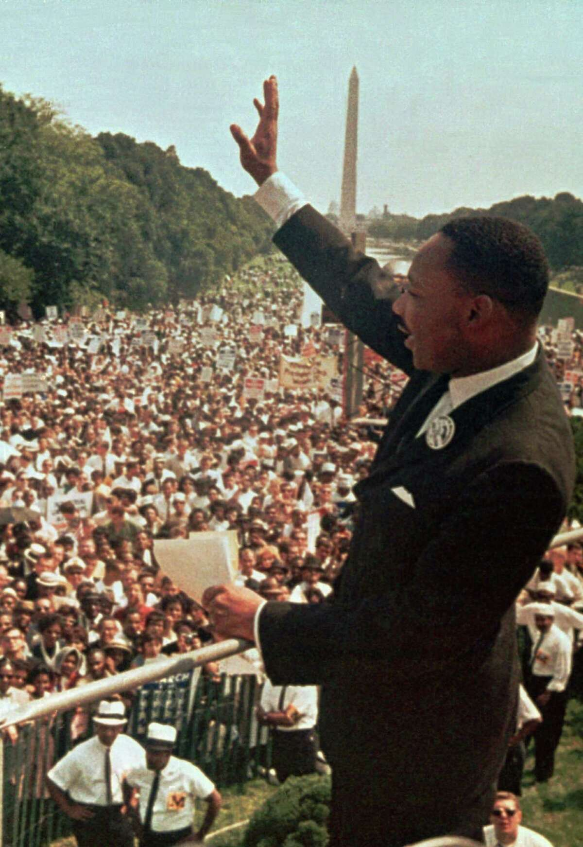 """Dr. Martin Luther King Jr. acknowledges the crowd at the Lincoln Memorial for his """"I Have a Dream"""" speech during the March on Washington, D.C. Aug. 28, 1963."""