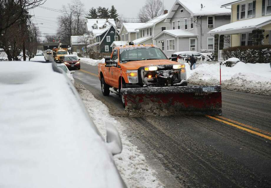 A Town of Greenwich plow clears snow from the road in the Byram section of Greenwich, Conn. Photo: Tyler Sizemore / Tyler Sizemore / Greenwich Time