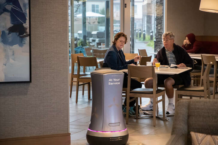 Rosé the robot communicates by the screen and makes robot sounds at The Hotel.