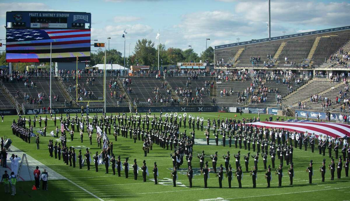 EAST HARTFORD, CT - SEPTEMBER 29: UConn band plays while the oversized flag is on the field prior to the start of the game as the Cincinnati Bearcats take on the UConn Huskies on September 29, 2018 at Rentschler Field in East Hartford, CT. (Photo by Williams Paul/Icon Sportswire via Getty Images)