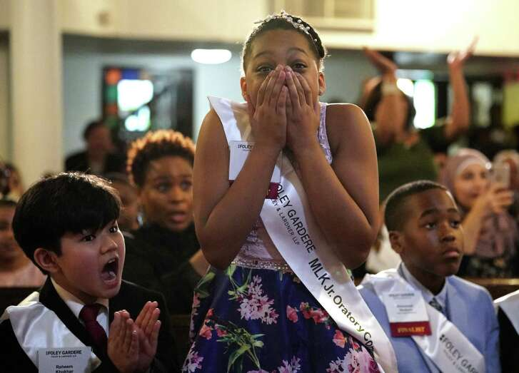 Nyla Johnson of Lockhart Elementary reacts as her name is called as the first place winner in the 23rd Annual Foley Gardere MLK Jr. Oratory Competition held at Antioch Missionary Baptist Church of Christ, 500 Clay Street, Friday, Jan. 18, 2019, in Houston. Other participants are shown, Raheem Khokhar of Sutton Elementary, left, and Emmanuel Akukoro of Valley West Elementary, right.
